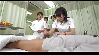 Japanese nurse shows other nurses how to give a handjob
