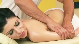 Massaging and drilling oiled brunette