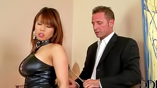 Well-endowed asian lady Tigerr Benson in sexy black dress gets handcuffed by elegant gent before she gets down on her knees and takes his dick in her mouth. Watch exotic lady with hands behind her back get face fucked on stairs