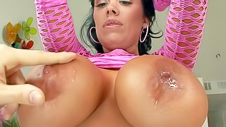 Sienna West is a gorgeous dark haired sexy milf with bubble ass and huge tits. She spreads her round buttocks in front of a lucky guy before she gets her massive tits licked. She removes her pink fishnet dress and shows her assets