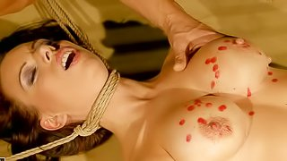 Bound beauty Vivien Bianchy with big tits and neat pussy gets hot drops of candle wax all over her helpless nude body before master whips out his sausage to fuck her face. Vivien Bianchy gives head after wax play