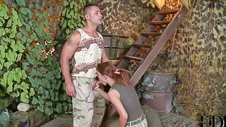 Redhead hottie Denise enjoys in giving head to her soldier fella on her knees, then gives him a footjob and gets her shaved taco nailed hard in the end in the army tent