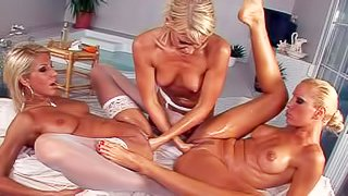 Three hot blondes, Sandy, Clara G and their hot friend enjoy in making a hot homemade lesbian threesome with lots of fisting, fingering and pussy licking going on on the bed