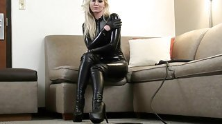 woman in catsuit & knee high boots