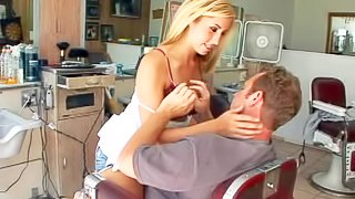Slutty good looking blonde nympho hair dresser with juicy gazongas and slim body in arousing white top and tight jeans seduces her mature customer and makes out with him in her salon