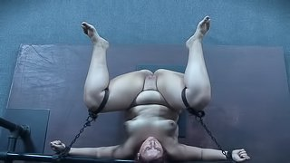 Fat naked chick submits to pain and punishment in the dungeon