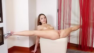 Flexible babe is torturing her holes