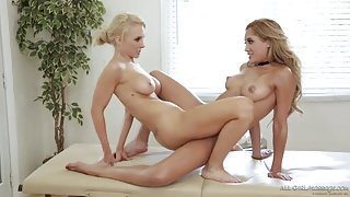 Tight blonde masseuse scissoring with a client