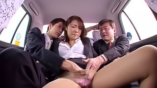 Japanese office girl enjoys sucking two cocks in a car